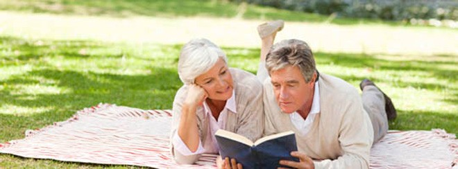 Man and women reading on grass