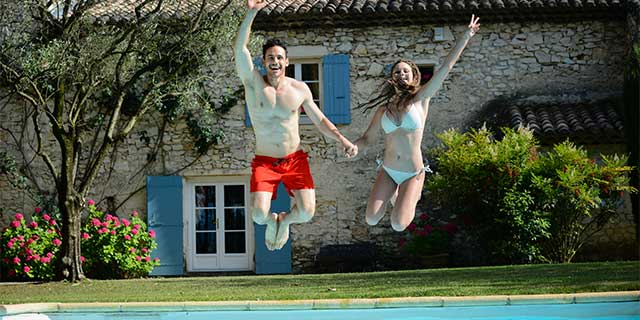 Man and woman jumping into swimming pool – eye surgery